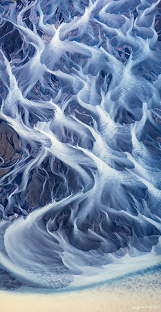 An abstract aerial photograph of the braided rivers of Southern Iceland by photographer Mieke Boynton